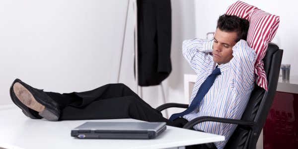 Complacent Sales Leader Relaxing with Feet Up On a Desk