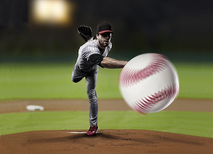 Pitcher Player throwing a ball, on a baseball Stadium.