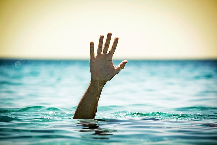hand above water line drowning