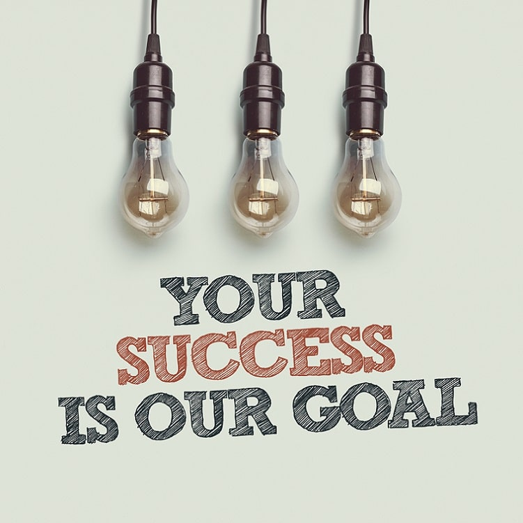sign saying your success is our goal