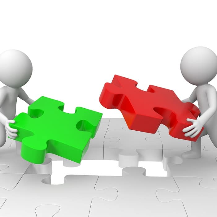two characters putting a jigsaw together connecting marketing and sales