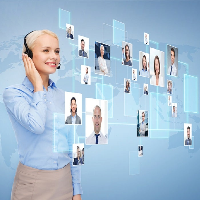 inside sales person talking on phone to multiple people