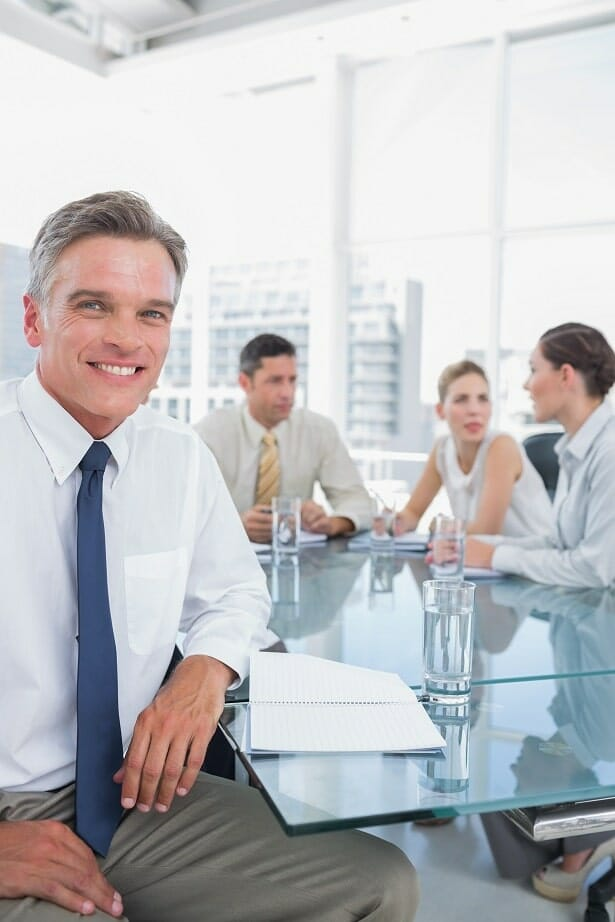 Business person in meeting with team of people