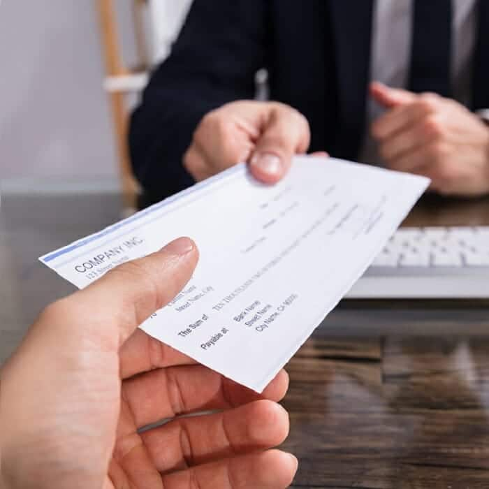 man receiving sales commission plan cheque