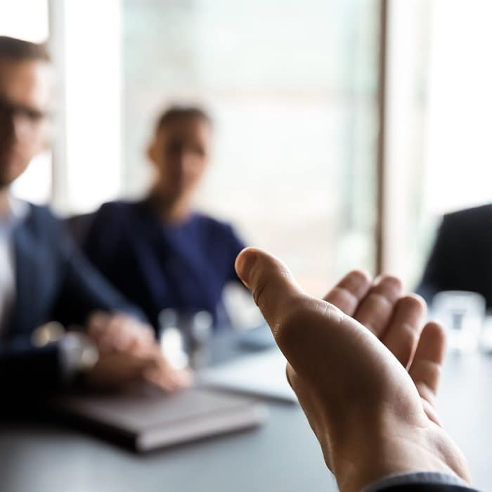 businessman extending hand to new customers