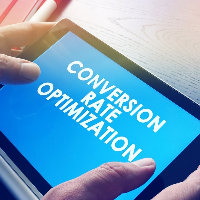 Man is holding Conversion rate optimisation report
