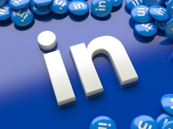 3d linkedin logo over a blue background surrounded by a lot of linkedin glossy pills
